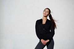 Athletic healthy girl dressed in sportswear posing outdoors Stock Photos