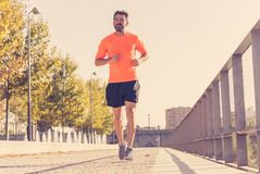 Athletic healthy runner jogging on the city street in Urban training workout stock photo