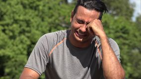 Athletic Hispanic Adult Male Crying. A handsome adult hispanic man stock footage