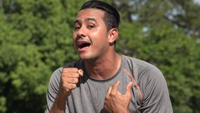 Athletic Hispanic Adult Male Singing. A handsome adult hispanic man stock footage