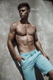 Athletic hot guy posing outdoors Stock Photo