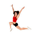 Athletic Jump. A woman does a gymnastic jump in the gym Stock Photos