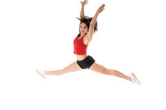 Athletic Jump. A woman does a gymnastic jump in the gym Stock Images