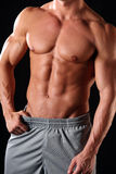 Athletic male. Fit, muscular and athletic male body stock photos