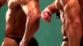 Athletic male bodybuilders posing sporting competitions event in bodybuilding stock video footage