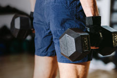 Athletic male with dumbbells workout Stock Photos