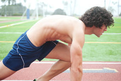 Athletic male runner in ready position Royalty Free Stock Photos