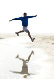 Athletic male running at the beach Stock Photos