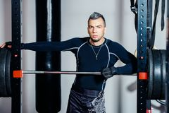 Athletic man with barbell royalty free stock photos
