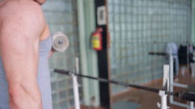 Athletic man. Biceps with dumbbells stock video footage