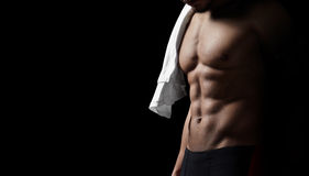 Athletic man on black background. Closeup Stock Image