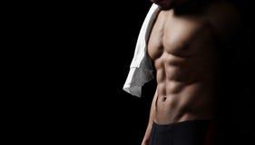 Athletic man on black background. Closeup Stock Image