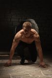 Athletic man on black backgrounds Royalty Free Stock Photo