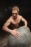 Athletic man on black backgrounds Royalty Free Stock Photos