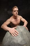 Athletic man on black backgrounds Stock Photography