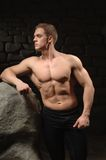 Athletic man on black backgrounds Royalty Free Stock Photography