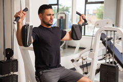 Athletic man building some muscle Royalty Free Stock Images