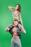 Athletic man carries on his shoulders smiling girl Royalty Free Stock Photos
