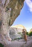Man climbs rock stock photos