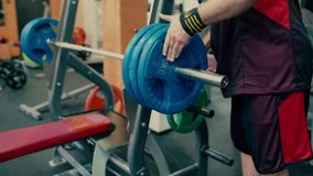 Athletic man do exercise with barbell stock video footage