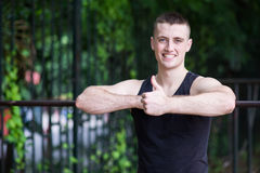 Athletic Man doing exercise with bar Stock Photos