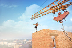 Athletic man doing exercise on high wall. Royalty Free Stock Images