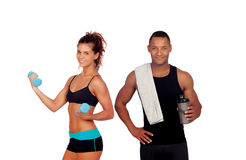 Athletic man after doing exercises drinking shaker proteincocktail and slim girl training stock image