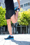 Athletic man doing a leg stretching Royalty Free Stock Photography