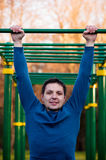 Athletic man doing pull-up on horizontal bar Royalty Free Stock Image