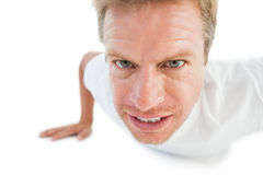 Athletic man doing push ups Stock Photography