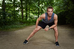 Athletic Man Doing Warm Up Exercise at the Park Stock Photography