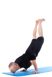 Athletic man doing yoga handstand in studio Royalty Free Stock Photo