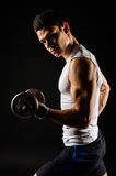 Athletic man with dumbbell Royalty Free Stock Images