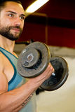 Athletic man with dumbbells Stock Photo