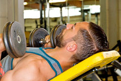 Athletic man with dumbbells Stock Images