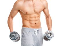 Athletic man with dumbbells on the white Royalty Free Stock Image