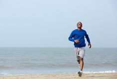 Athletic man enjoying a jog at the beach Royalty Free Stock Image