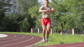 Athletic man exercising outdoors stock video footage