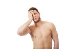 Athletic man feeling pain in his head. Stock Photos