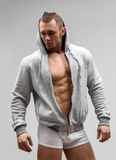 Athletic Man Fitness Model Posing In Underwear and. Hoodie Royalty Free Stock Photos