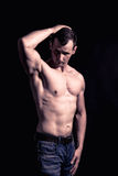 Athletic Man Fitness Model. Studio shoot. Low key. After LR. Skin retouch undone Stock Photos