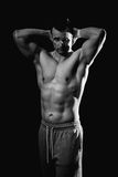 Athletic Man Fitness Model. Studio shoot. Low key. After LR. Skin retouch undone Stock Photography