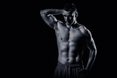 Athletic Man Fitness Model. Studio shoot. Low key. After LR. Skin retouch undone Stock Photo