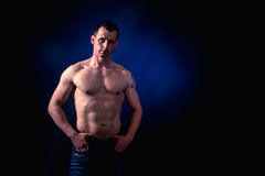 Athletic Man Fitness Model. Studio shoot. Low key. After LR. Skin retouch undone Royalty Free Stock Photography