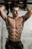 Athletic Man Flexing Stock Photos
