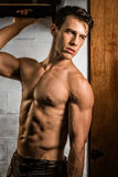 Athletic Man Flexing Stock Images