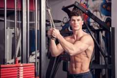 Athletic man in the gym looking at the camera Royalty Free Stock Image