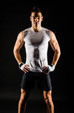 Athletic man with hands on his hips Royalty Free Stock Photo