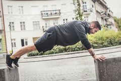 Athletic man training on a street. Stock Photography