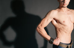 Athletic man with his shadow in the background Stock Photo